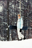 Young woman with snowboard on ski slope Stock Image