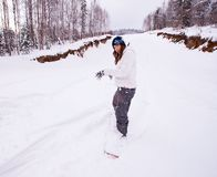 Young woman snowboarding Royalty Free Stock Images