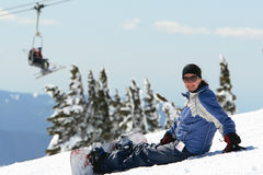 Young woman snowboarding stock photo