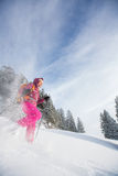 Young woman snowshoeing in high mountains Stock Photography