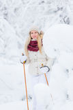 Young woman snowshoeing Stock Images