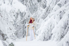Young woman snowshoeing Royalty Free Stock Images