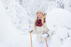Young woman snowshoeing Stock Image