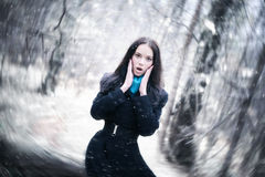 Young woman in a snowstorm. Background blur effect Stock Photo