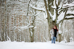 Young woman and snowy forest Royalty Free Stock Image