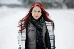 Young woman and snowy forest Stock Photo