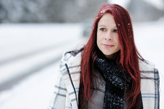 Young woman in snowy forest Royalty Free Stock Photo