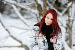 Young woman in snowy forest Stock Photography
