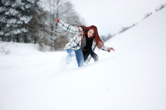 Young woman in snowy forest Stock Photos