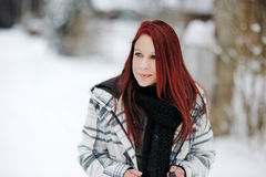 Young woman in snowy forest Stock Image
