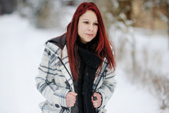 Young woman in snowy forest Stock Photo