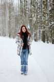 Young woman in snowy forest Stock Images