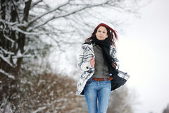 Young woman in snowy forest Royalty Free Stock Photos
