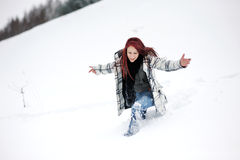 Young woman in snowy forest Royalty Free Stock Photography