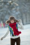 Young woman in a snowy furry hood Royalty Free Stock Images