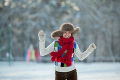Young woman in a snowy furry hood Stock Photography