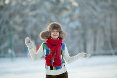 Young woman in a snowy furry hood Royalty Free Stock Photos