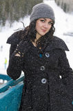 Young Woman on a Snowy Winter Day Royalty Free Stock Image