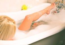 Free Young Woman Soaking In A Foamy Bath Stock Photo - 1297480