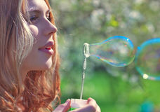 Young woman with soap bubbles Royalty Free Stock Photos