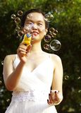 Young woman with soap bubbles Stock Images