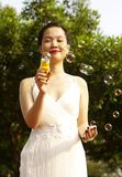 Young woman with soap bubbles Royalty Free Stock Photography