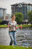 Young woman with soap bubbles. Royalty Free Stock Photography