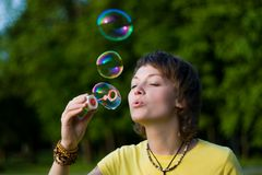 Young woman and soap-bubbles Stock Photos