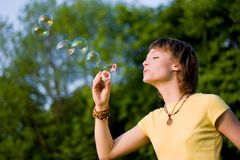 Young woman and soap-bubbles Stock Images