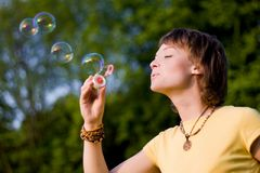 Young woman and soap-bubbles Stock Photography