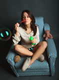 Young woman with soap bubbles Royalty Free Stock Image