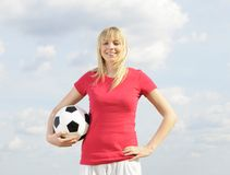 Young woman with soccer ball Royalty Free Stock Photo