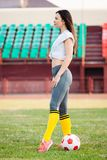Young woman with soccer ball at stadium royalty free stock photography