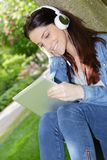 Young woman socializing through tablet. Young woman socializing through the tablet Royalty Free Stock Image