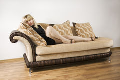 Young Woman on a sofa Stock Photography