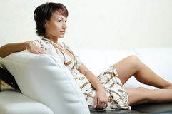 A young woman on a sofa stock image