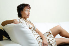 A young woman on a sofa stock images