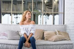 Young woman on the sofa Stock Image