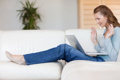 Young woman on the sofa waiting Stock Image