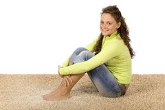 Young woman on the soft and comfortable carpet. Isolated on white young woman on the soft and comfortable carpet stock photo