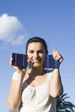 Young woman with a solar cell Stock Images