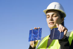 Young woman with  solar cells Royalty Free Stock Image