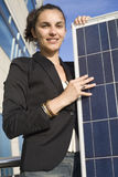 Young woman with solar panel Royalty Free Stock Image