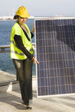Young woman with  a solar panel Stock Photography