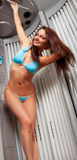 Young woman in a solarium. Young beautiful woman in bikini  in a solarium Royalty Free Stock Images