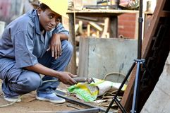 Young woman welder at work. Royalty Free Stock Photography
