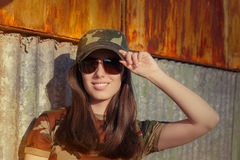 Young Woman Soldier in Camouflage Outfit Saluting stock photos