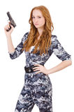 Young woman soldier with gun. On white stock photography