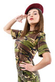 Young woman soldier in military camouflage outfit Royalty Free Stock Image