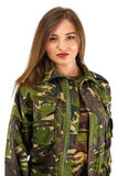 Young woman soldier in military camouflage outfit Royalty Free Stock Photos